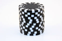 Stack of Black Casino Chips. Isolated stack of black casino chips royalty free stock images