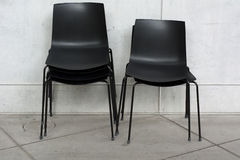 Stack of Black Chairs Royalty Free Stock Photo