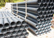 Stack of black corrugated plastic pipes.  Stock Photos