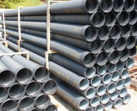 Stack of black corrugated plastic pipes.  Royalty Free Stock Photo