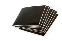 Stack of black covered magazines Royalty Free Stock Photos
