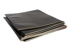Stack of black covered magazines Royalty Free Stock Image