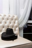 Stack of black-hat on couch Royalty Free Stock Image