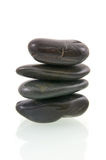 Stack of black massage stones. Isolated on white background Royalty Free Stock Photography