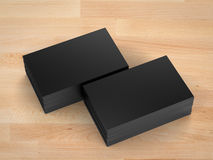 Stack of black name cards. 3d rendering stack of black name cards on wooden table Royalty Free Stock Photos
