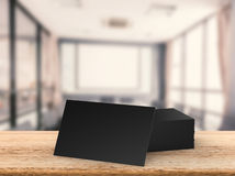 Stack of black name cards. 3d rendering stack of black name cards on wooden table Stock Images