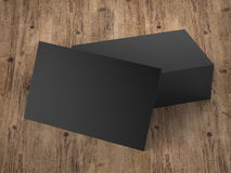 Stack of black name cards. 3d rendering stack of black name cards on wooden table Royalty Free Stock Images