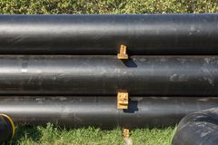 Stack of black pipes Stock Photo