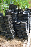 Stack black plastic baskets. Royalty Free Stock Images