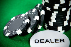 Stack of black poker chips Stock Photos