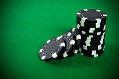 Stack of black poker chips Royalty Free Stock Photos
