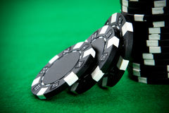 Stack of black poker chips Stock Photo