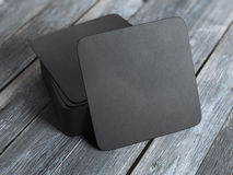 Stack of black square beer coasters. 3d rendering Stock Photos