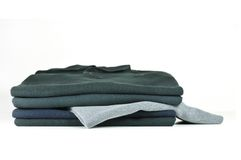 Stack of black T-Shirts Stock Photography
