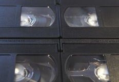 Stack of black VHS tape video cassettes close up.  stock photos