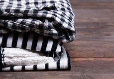 Stack of black and white clothes with striped and checkered patt Royalty Free Stock Image
