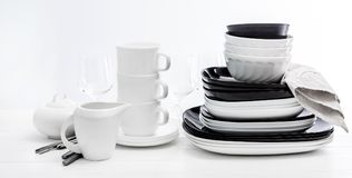 Stack of black and white plates and mugs Royalty Free Stock Image