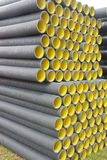 Stack of black yellow corrugated plastic pipes.  Royalty Free Stock Photo
