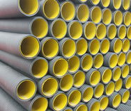 Stack of black  yellow corrugated plastic pipes Stock Image