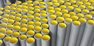 Stack of black yellow corrugated plastic pipes royalty free stock photography