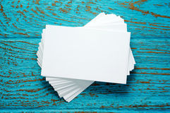 Stack of blank business cards. On blue wood desk Stock Photo