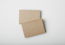 Stack of blank craft business cards on white background with soft shadows. Royalty Free Stock Photos