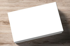 Stack of blank name cards. On wooden background Royalty Free Stock Images