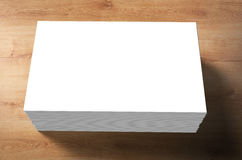 Stack of blank name cards. On wooden background Stock Image