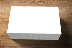 Stack of blank name cards. On wooden background Royalty Free Stock Photography