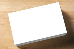 Stack of blank name cards. On wooden background Stock Photo
