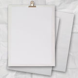 Stack of blank paper book on texture background Stock Images