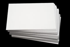 A stack of blank white busines. S cards, isolated on a black background Stock Photos