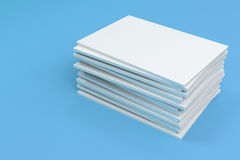 Stack of blank white closed brochure mock-up on blue background. Magazine cover template. 3D rendering illustration Royalty Free Stock Image
