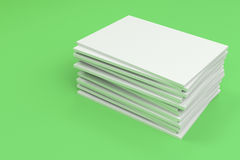 Stack of blank white closed brochure mock-up on green background. Magazine cover template. 3D rendering illustration Royalty Free Stock Photo