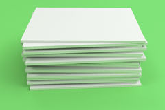 Stack of blank white closed brochure mock-up on green background. Magazine cover template. 3D rendering illustration Royalty Free Stock Photography