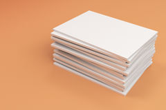 Stack of blank white closed brochure mock-up on orange background. Magazine cover template. 3D rendering illustration Royalty Free Stock Photography