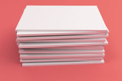 Stack of blank white closed brochure mock-up on red background. Magazine cover template. 3D rendering illustration Royalty Free Stock Photos