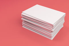 Stack of blank white closed brochure mock-up on red background. Magazine cover template. 3D rendering illustration Royalty Free Stock Photo