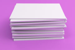 Stack of blank white closed brochure mock-up on violet background. Magazine cover template. 3D rendering illustration Royalty Free Stock Images
