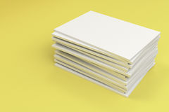 Stack of blank white closed brochure mock-up on yellow background. Magazine cover template. 3D rendering illustration Royalty Free Stock Photography
