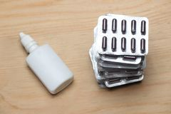Stack blister pack and white dropper bottle royalty free stock photography