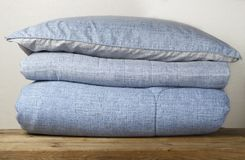 Stack of blue bed linen close up, front view, background stock images