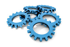 Stack of blue colored metallic cogwheels on white surface Stock Photo