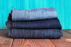 Stack of blue and dark blue jeans Stock Images