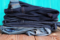 Stack of blue and dark blue jeans Stock Image
