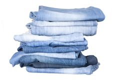 Stack of blue denim jeans. Front view of stack, blue denim jeans stock image