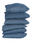Stack of blue denim pillows Royalty Free Stock Image