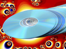 Stack of Blue Disks Discs with Red Background. CDs DVDs Blu-ray Stack of Blue Disks Discs with Psychedelic Bright Orange Fractal Background Royalty Free Stock Image