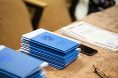 A stack of blue graduations lay on the table royalty free stock image