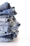 Stack of blue jean. On white background Royalty Free Stock Photography